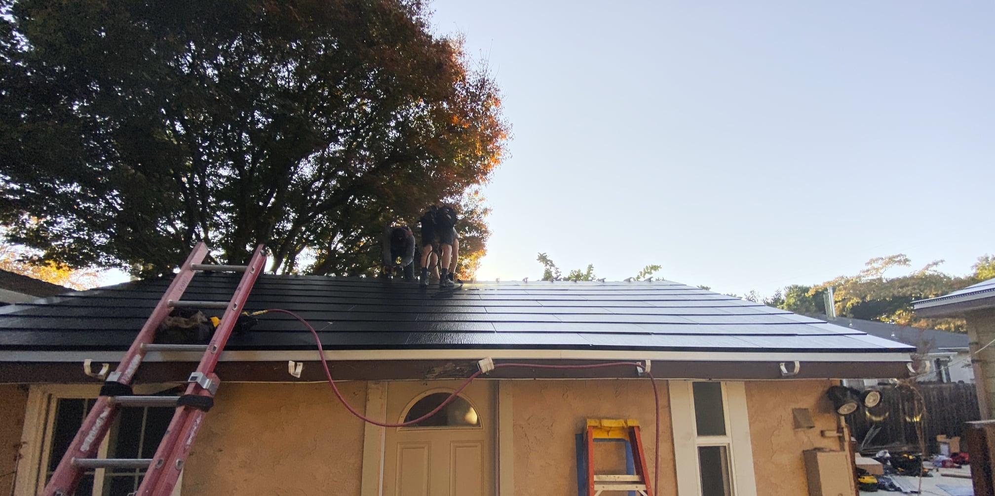 The Tesla Solar Roof on the garage, just before the final trim goes up.
