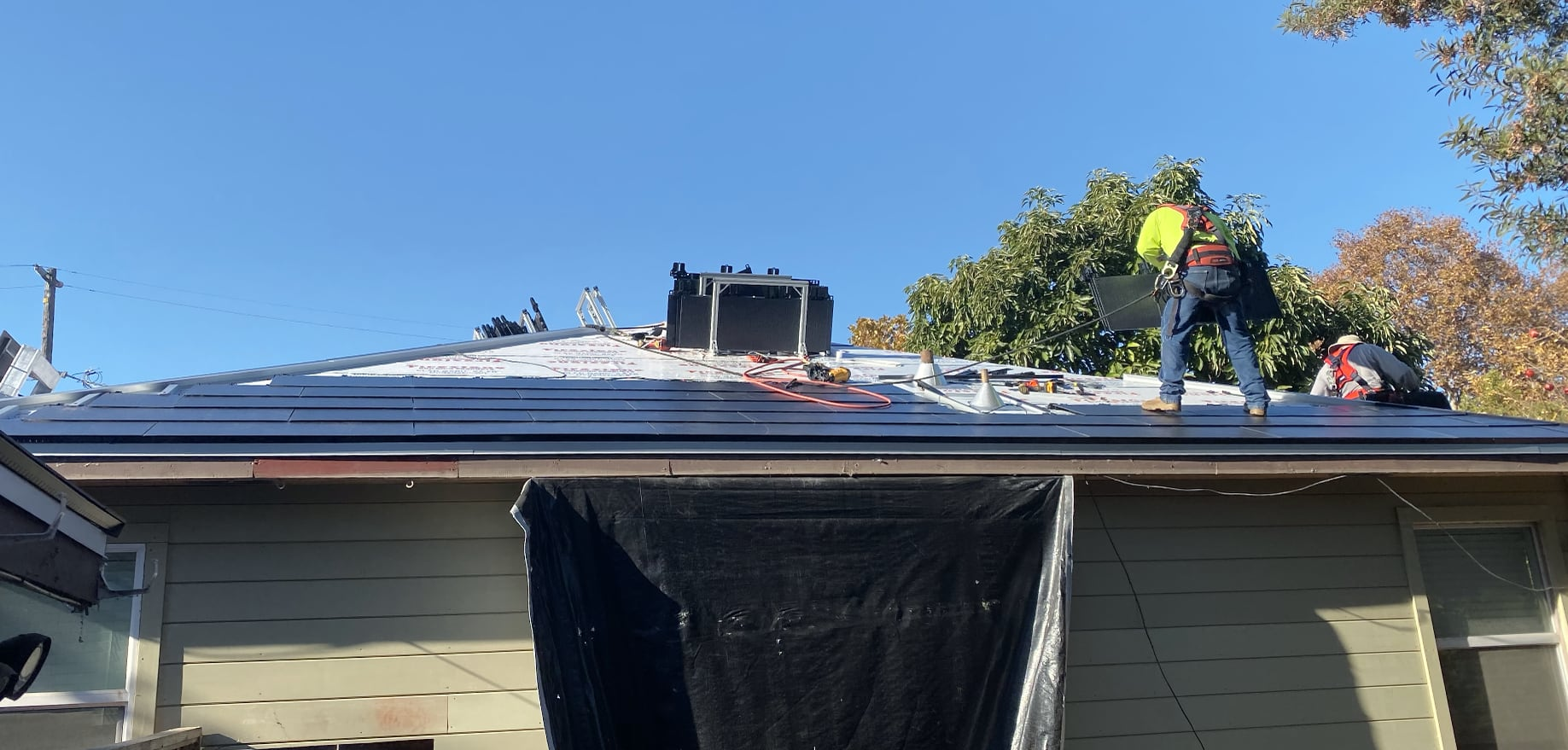 >Solar Roof installation underway, featuring the roof about 50% full of Tesla Solarglass tiles.